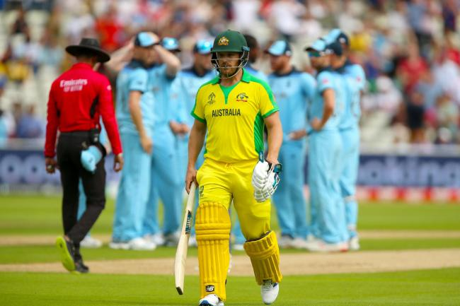 Aaron Finch departs as England celebrate the Australia captain's wicket