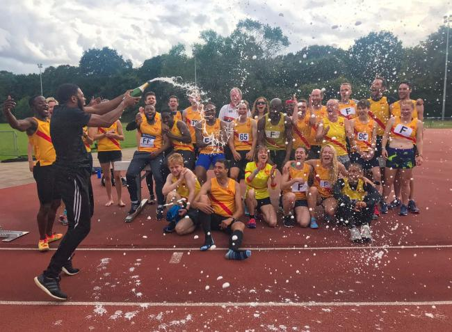 Hercules Wimbledon athletes celebrating gaining promotion after lifting the Southern League Division Three South-East title at Tooting Bec on Saturday winning all five of this season's matches.