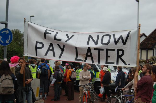Environmental activists at Heathrow. Image: Andrew via Flickr