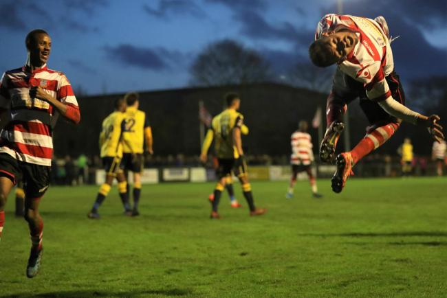 Kingstonian's Dan Bennett leaps for joy after sealing a 3-1 win over local rivals Woking in the FA Trophy on Sunday. Pic: Simon Roe