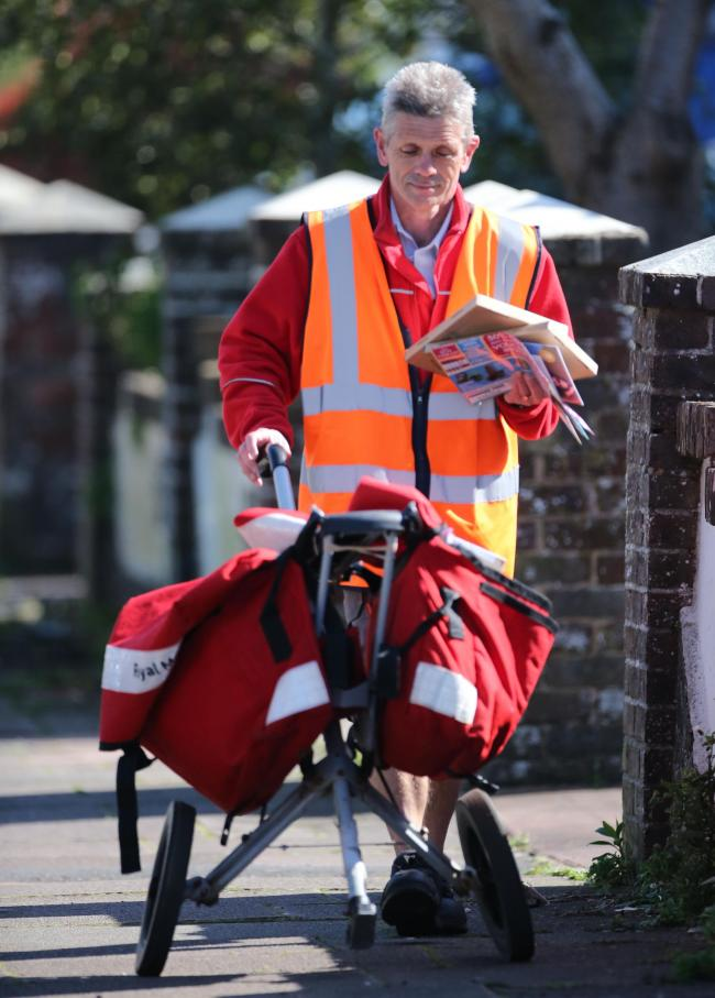 A Royal Mail worker in Worthing today