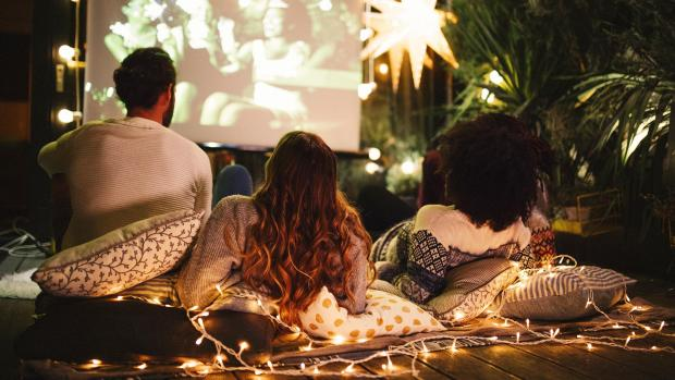 Richmond and Twickenham Times: Sit back and relax with a projector and outdoor screen. Credit: Getty Images / M_A_Y_A