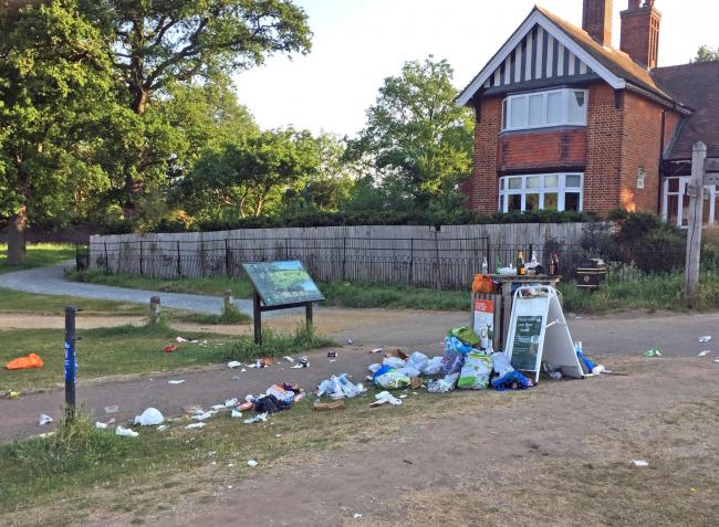 Photo issued by The Royal Parks showing litter and an overflowing bin in Richmond Park, London. The Royal Parks litter pickers collected more than 250 tonnes of rubbish from eight green spaces including Bushy Park and Greenwich Park over June