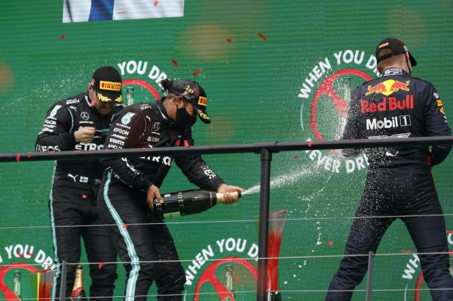 Lewis Hamilton, centre, made F1 history on Sunday in Portugal