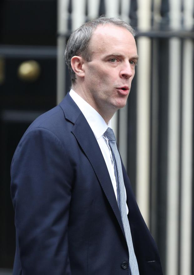 Richmond and Twickenham Times: Foreign Secretary Dominic Raab arrives in Westminster ahead of the post-lockdown announcement. Image: Yui Mok/PA Wire.
