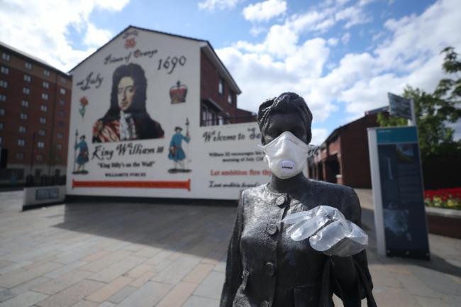 A statue wearing PPE in Belfast