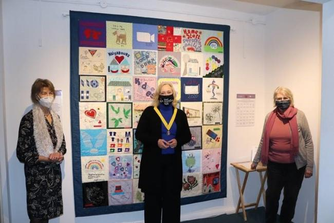 Maggie Pope (who created one of the patchwork pieces), Cllr Nancy Baldwin and Sue Brown at the Museum of Richmond in December 2020.