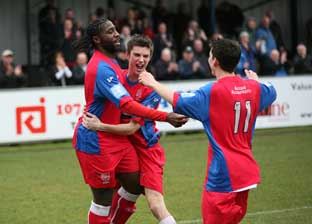 Goal:  Beavers striker Craig Dundas (left) celebrates his goal with Dean Inman and Dave Tarpey in Hampton's 4-1 win over Eastleigh on Saturday.  Pic: Jeff Beasley.