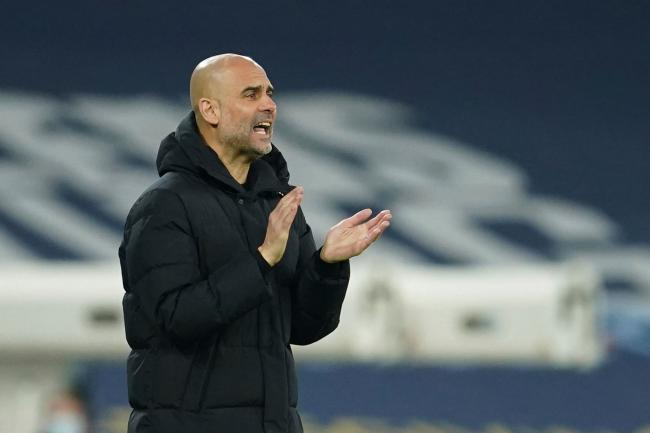 Pep Guardiola applauds on the touchline