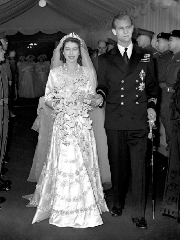 Richmond and Twickenham Times: Princess Elizabeth and the Duke of Edinburgh leaving Westminster Abbey after their wedding ceremony (PA)