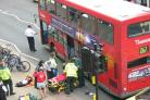 Accident scene: A student was hit by a bus in London Road, Twickenham, today