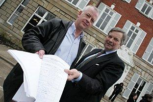 Sign here: Anthony Kennedy handing a petition to council leader Lord True