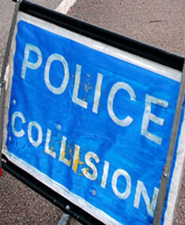 Crash blocks road outside primary school