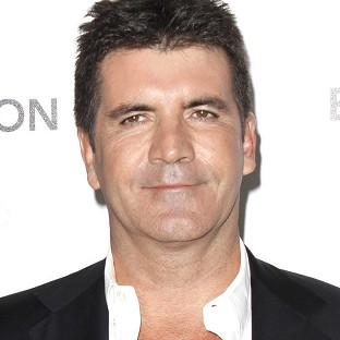 Simon Cowell says he would happily work with Cheryl Cole again, even though their falling out was 'pretty bad'