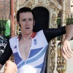 Richmond and Twickenham Times: WHAT A HERO: Bradley Wiggins on his throne at Hampton Court Palace after winning his gold medal