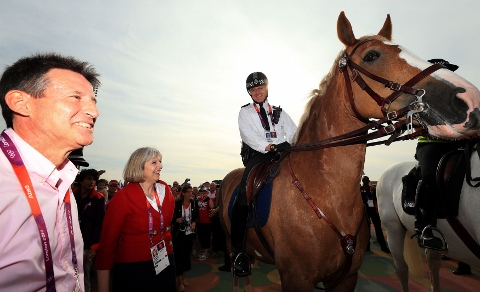 Richmond and Twickenham Times: British Home Secretary Theresa May and LOCOG Chairman Sebastian Coe meet Mounted Police Officer Sergeant Darren Duffy in the Olympic Parktoday.