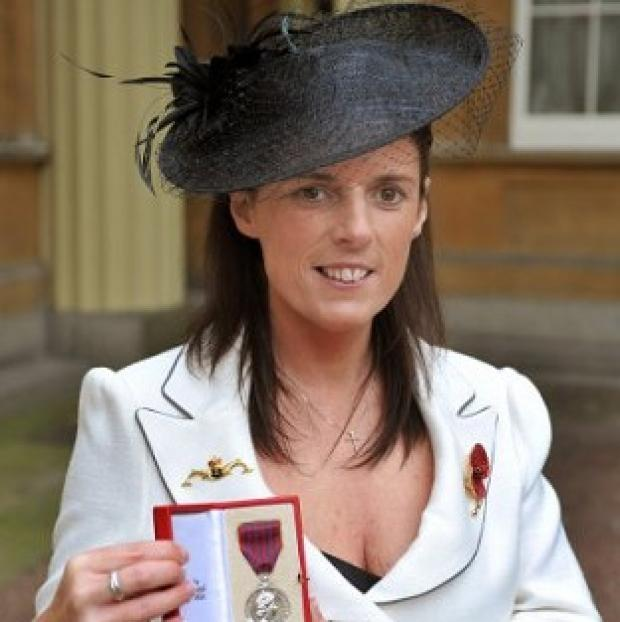 Gillian Molyneux holds the George Medal awarded to her late husband Lieutenant Commander Ian Molyneux