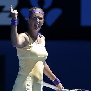 Victoria Azarenka of Belarus celebrates after defeating Romania's Monica Niculescu (AP)