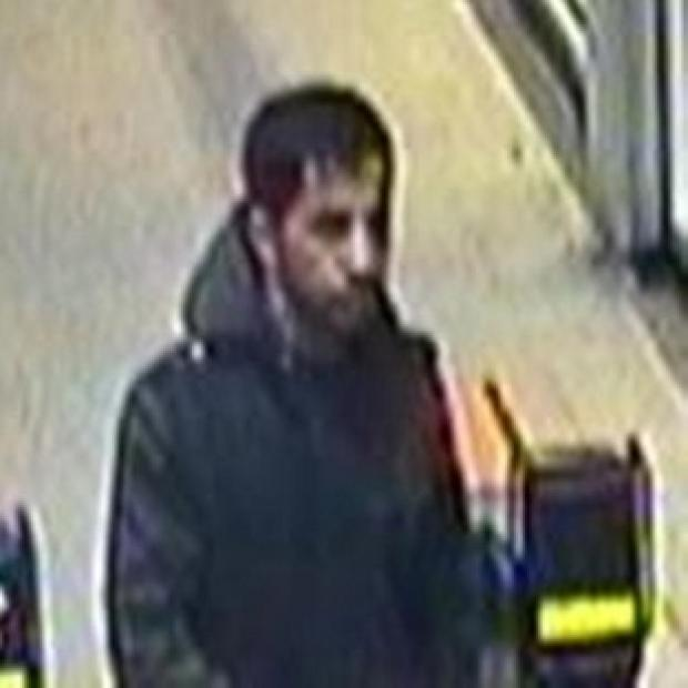 British Transport Police issued a CCTV image of the man they want to trace after a bottle of hydrochloric acid was left on a train