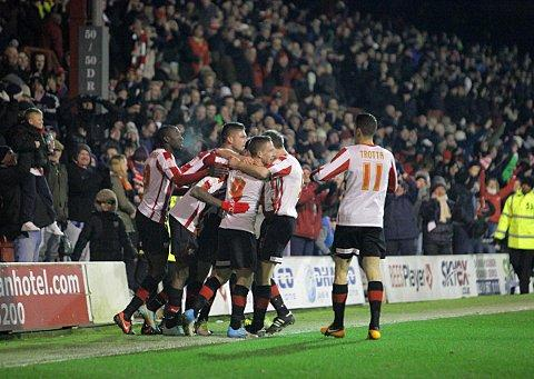 You beauty: Clayton Donaldson is mobbed by his team mates after hitting the winner on Tuesday