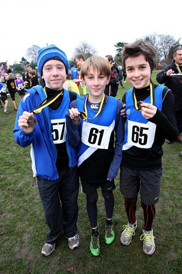 Team spirit: Aaron Bruce, Jorge Beltrao and Sam Shaw - here with medals from the Surrey Cross Country Championships last month - are firing Harriers to glory 	Deadlinepix SP72882