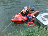 Saved: A woman was pulled out of the water thanks to a local ferryman and a passer-by