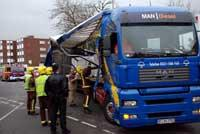 Richmond and Twickenham Times: Emergency services survey the damage to the lorry Deadlinepix KT12844