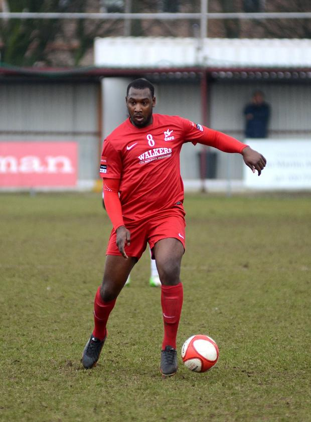 Richmond and Twickenham Times: Hakeem Adelakun playing for Carshalton Athletic