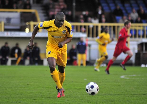 Richmond and Twickenham Times: Michael Boateng playing for Sutton United
