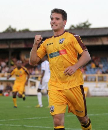 Sutton United player Jamie Taylor celebrates a goal at Gander Green Lane