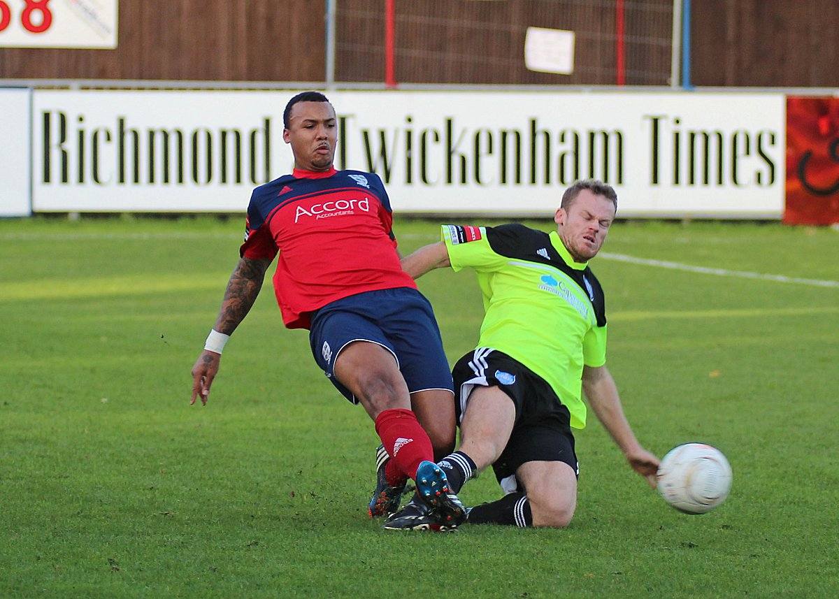 On his way: Hampton and Richmond Borough's Marcus Rose nips in to disposses