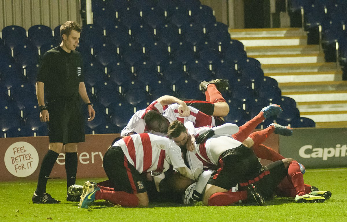 Hup hup: Daniel Sweeney is mobbed by his Kingstonian team-mates after b