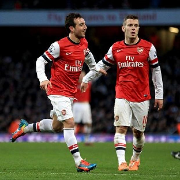 Richmond and Twickenham Times: Santi Cazorla, left, scored a second-half brace to claim all three points for Arsenal