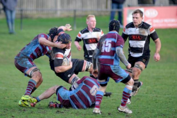 Richmond and Twickenham Times: Battle: Sutton & Epsom's Mike Blakeburn is tackled during the 22-10 defeat to neighbours Wimbledon                             Pictures: Ben Mole/Sutton & Epsom RFC