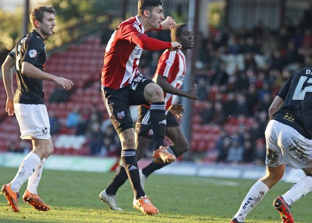 On song: Brentford's in-form Italian hitman Marcello Trotta