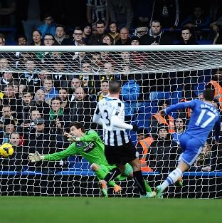 Eden Hazard scores the first of his hat-trick against Newcastle
