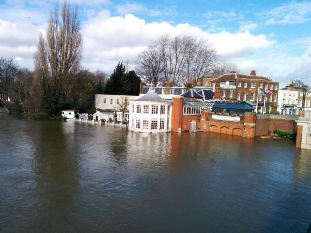 Flooding: The Mitre hotel opposite Hampton Court Palace Credit: Mike Walker