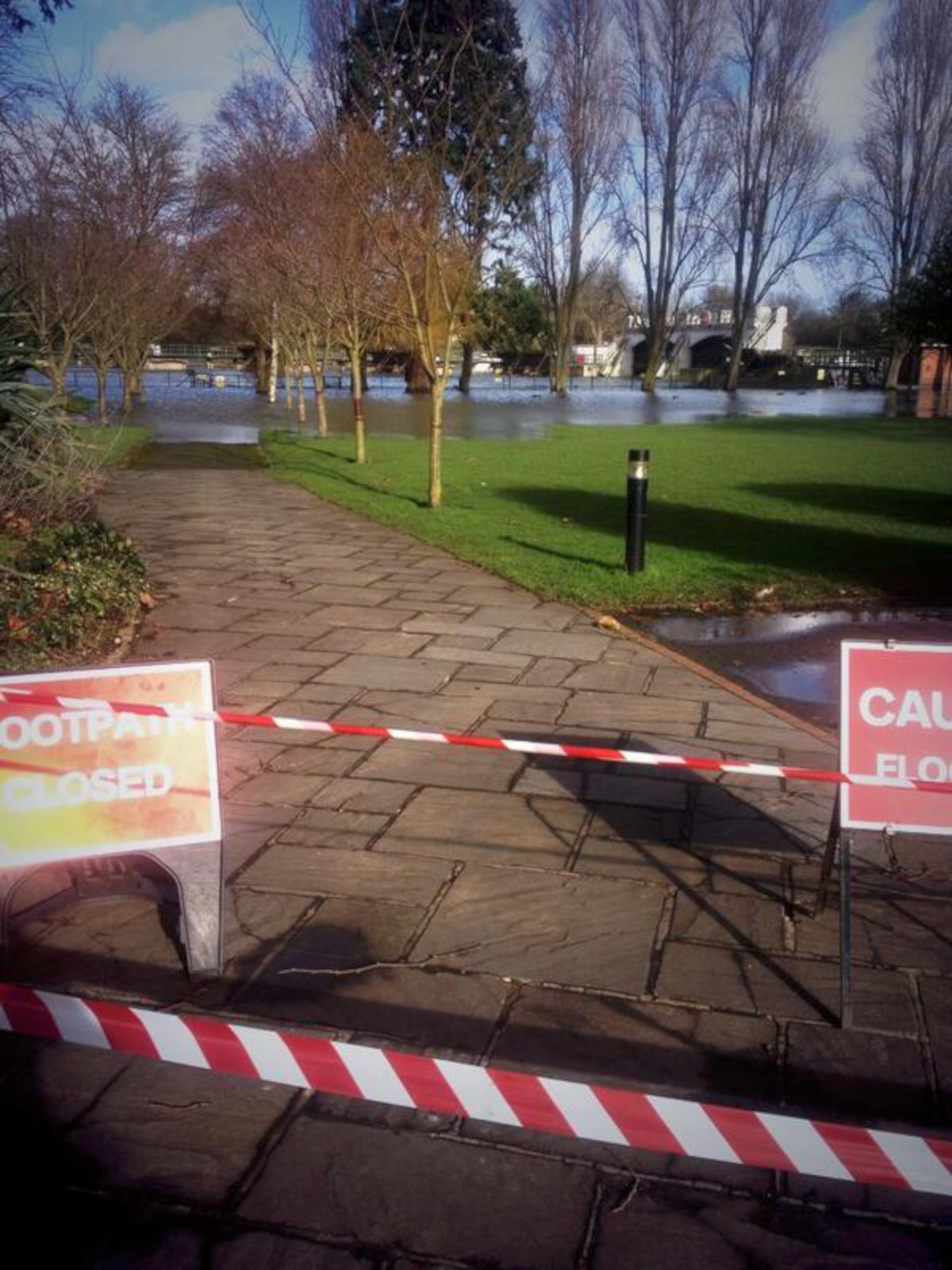 Flooding: A path at the Lensbury in Teddington