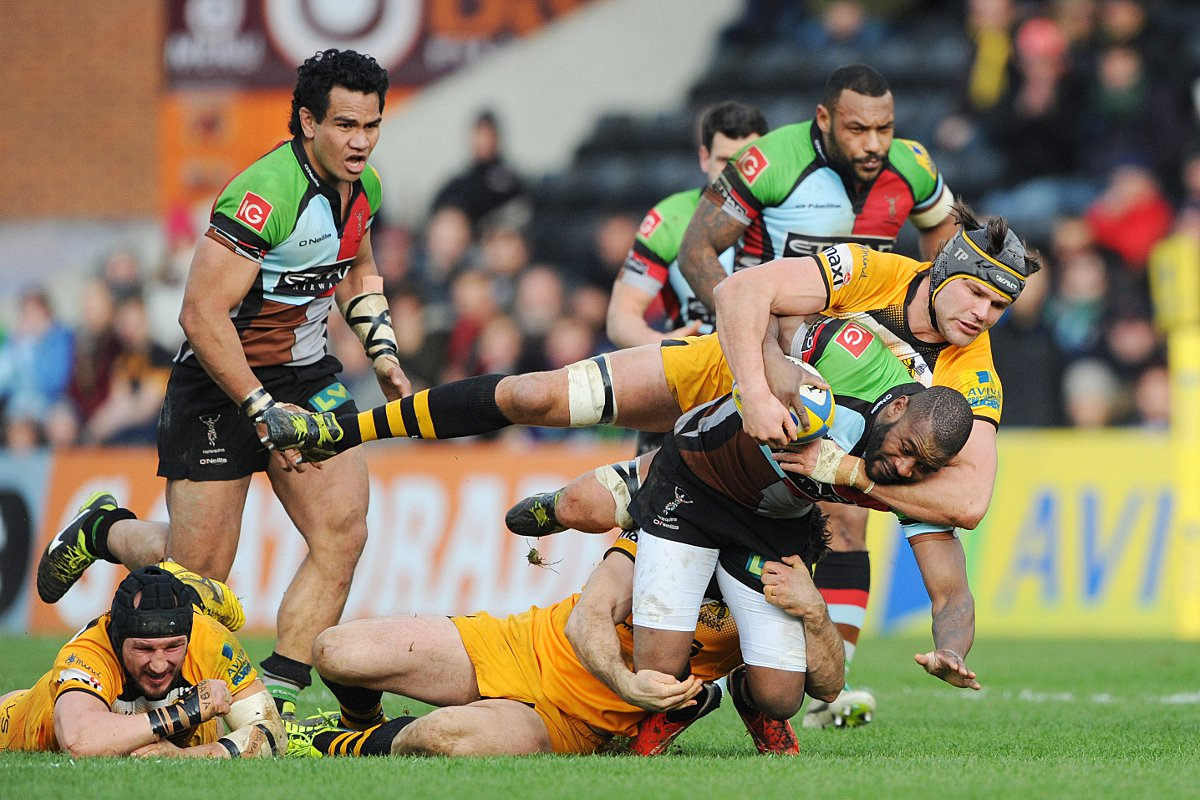 Battle hardened: Quins winger Ugo Monye is halted by Wasps lock Tom Palmer, with Maurie Fa'asavalu and Jordan Turner Hall in close attendanc