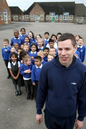 Full Nelson: Jon Graham with pupils from the school