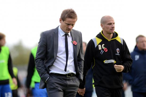 Food for thought: Neal Ardley's Dons went down 1-0 at Portsmouth on Saturday              SP79028