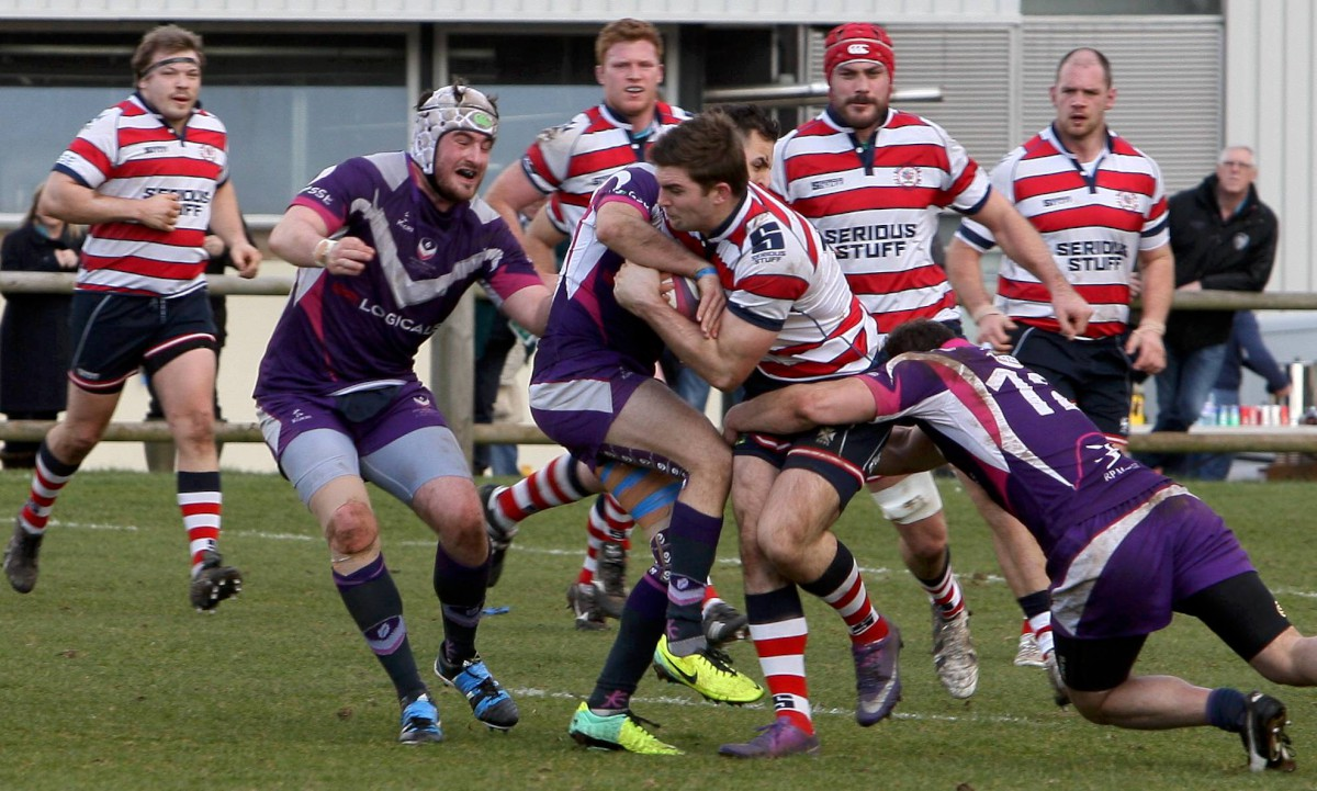 Hanging on: Rosslyn Park's Henry Staff under pressure in the narrow win at