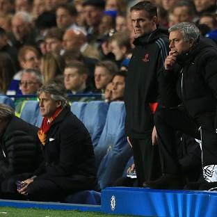 Chelsea manager Jose Mourinho, right, was delighted to see his side go through