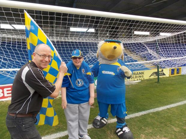 On your marks for Sport Relief: Danny Wiggins, centre, will take on Haydon the Womble in a race to the centre circle on Saturday - Clive Yelf has the flag all set