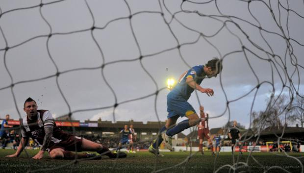 Get in there: Jack Midson hits the winner as AFC Wimbledon come back from the dead to beat Cheltenham 4-3             All pictures: David Purday