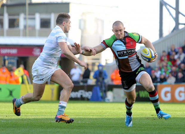 Big impact: Harlequins full back Mike Brown hands off London Irish's Australia international James O'Connor during Saturday's vital 23-9 Premiership triumph at the Stoop