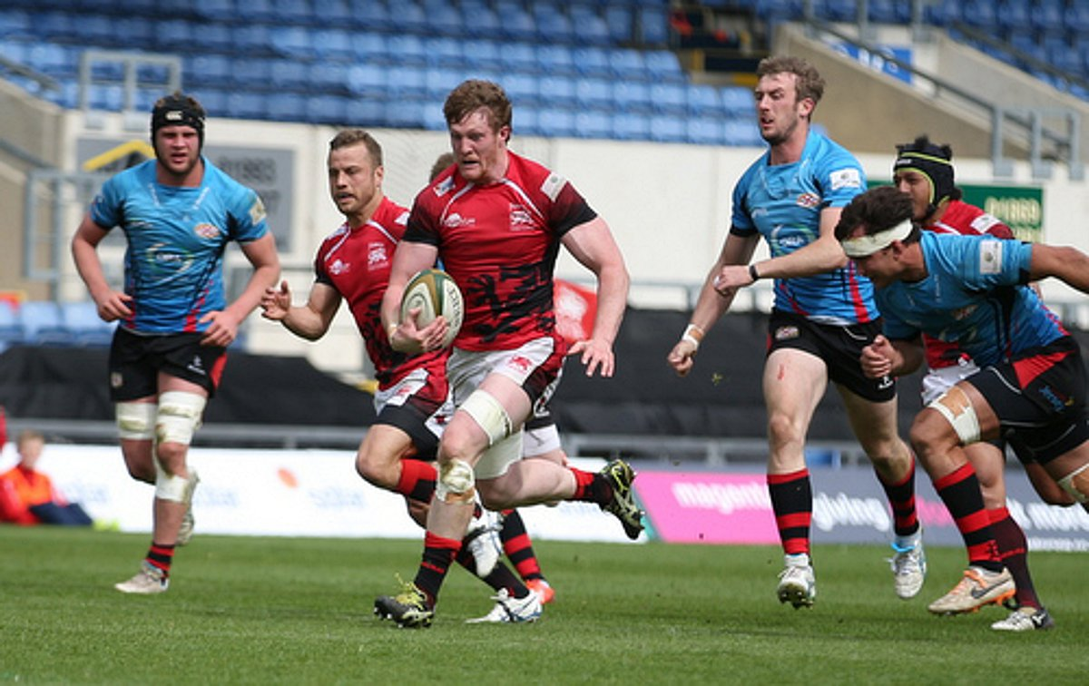 Running with the ball: London Welsh flanker John Quill bursts through the jersey defence at the Kassam stadium on Saturday