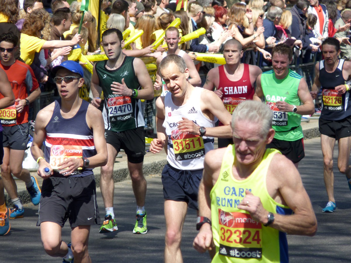 Pounding the streets: Neil Aikman in action in the Virgin London marathon