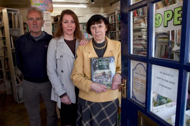 Back in business: Ray Brown, actress Julie Bevan and Joy Mckie who has run the shop for 16 years