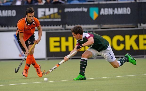 Losing battle: Surbiton's Jonathan Gall gets stuck in to the Oranje Zwart defence in last Thursday's EuroHockey League defeat                     	Picture: Hockeyimages.co.uk